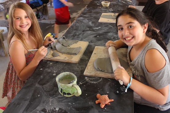 Campers doing Ceramics in the Art Department